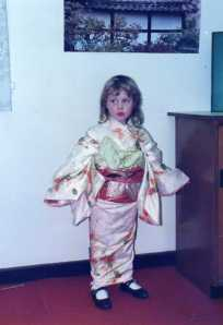 In a Kimino at age 4. The Japanese culture and the travel bag would stay with me