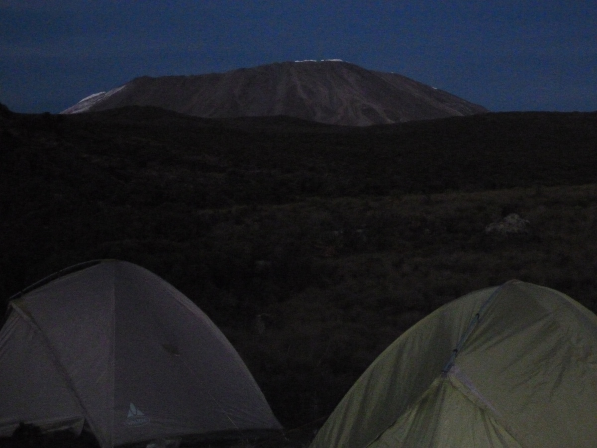 An incredible night view from Kikelelwa of the amazing Kibo that we will later climb