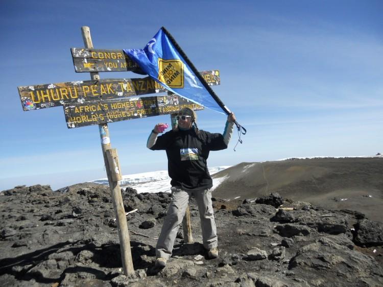 Emma standing on top of Uhuru Peak