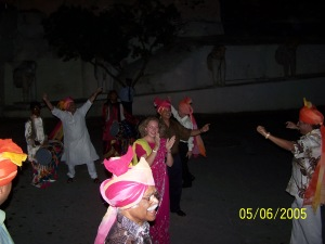 Dancing in the streets of Udaipur in a procession in India