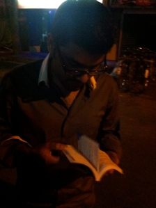 My friend Priyo laughing hysterically at my hindi book