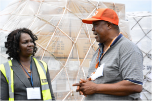 World Vision Sierra Leone's National Director, Leslie Scott making the official hand-over to Sierra Leone's Deputy Minister of Health and Sanitation, Madam Madina Rahman. Medical Supplies arrive to help combat the Ebola outbreak. Photo by Jonathan Bundu, World Vision