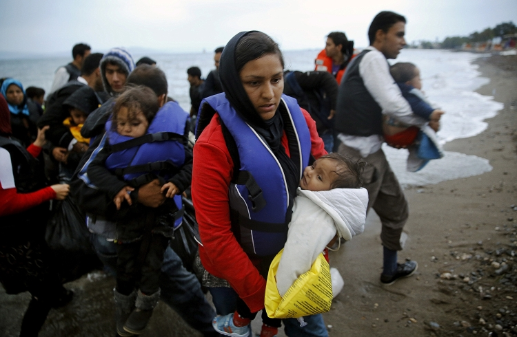 Afghan immigrants land at a beach on the Greek island of Kos after crossing a portion of the south-eastern Aegean Sea between Turkey and Greece on a dinghy early May 27, 2015. Despite the bad weather at least a dingy with over thirty migrants made the dangerous voyage to Greece. REUTERS/Yannis Behrakis      TPX IMAGES OF THE DAY      - RTX1EPUP