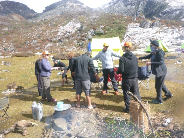 Working as a team with our staff at Camp - clearing the snow melted water from the cooking tent