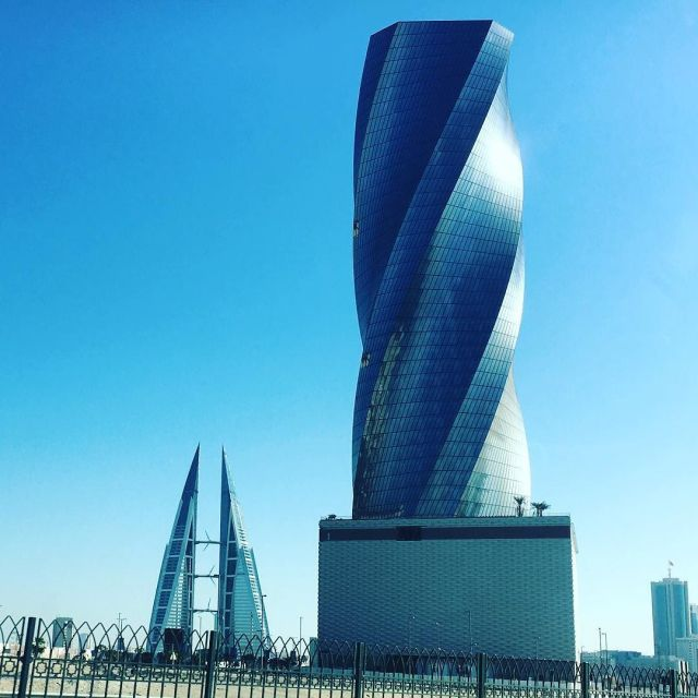 more_sightseeing_by_car-_love_this_twisty_office_building_near_the__bahrain_financial_harbour_and_in_the_distance_the__bahrainworldtradecentre-1
